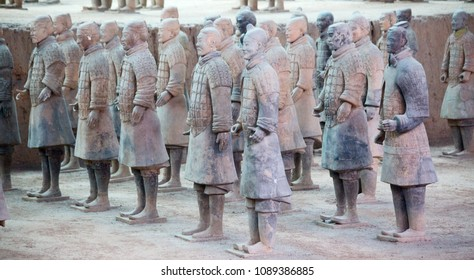 XIAN, CHINA - October 8, 2017: Famous Terracotta Army in Xi'an, China. The mausoleum of Qin Shi Huang, the first Emperor of China contains collection of sculptures depicting armored men and horses.