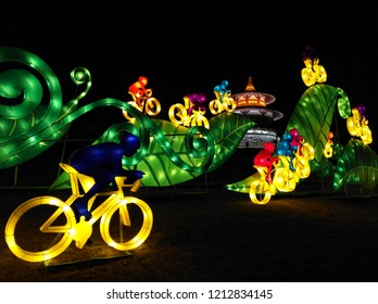 Xian city, Shaanxi province, China - February 24, 2018. Colorful people silhouettes riding ofo bikes. Chinese lantern festival in Tang Paradise park, Xian city, China.