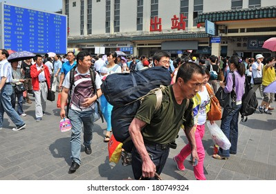 XIAN - OCT 7: large crowd of people travel during National Day holiday on October 7, 2013 in Xian, China. During the one week holiday over 70 million people traveled by train only.