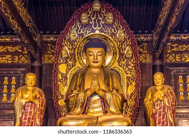 Xian, Shaanxi Province / China - August 4th 2015: Golden Buddha statue at Giant Wild Goose Pagoda in Xian, China