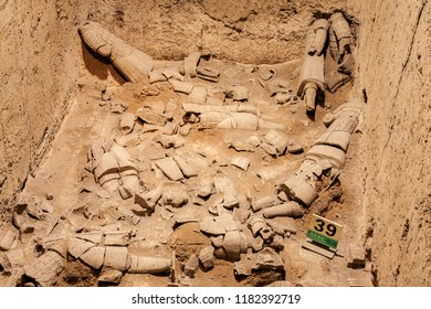 XIAN,CHINA - NOVEMBER 11, 2011 :The Terracotta Army or the Terra Cotta Warriors in their original state when unearthed in Qin Shi Huang Emperor's tomb of 210-209 BC.