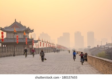 XIAN,CHINA -OCT 23 :Sunset view with tourists on the West Gate of Xian City Wall ,one of the oldest and best preserved Chinese city walls October 23, 2013 in Xian of Shaanxi Province, China.