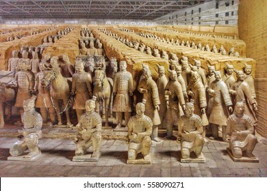 XIAN,CHINA-JULY 24,2016:Replica of terracotta army in their graves in Xian, China. Terracotta army is a collection of terracotta sculptures depicting the armies of Qin Shi Huang, the first Emperor