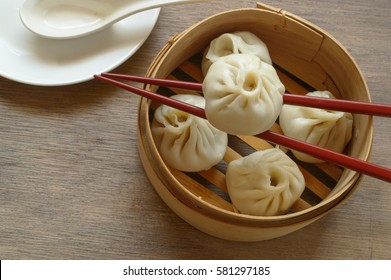Xiao Long Bao - Chinese Soup Dumpling is a type of steamed bun ) from the Jiangnan region of China,