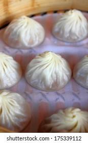 Xiao Long Bao, steamed pork dumplings with soup inside served in bamboo steamer