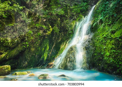 Xiao Yintang Waterfall of Yangmingshan National Park with milky cold spring and sunlight on sunny day, shot in Taipei, Taiwan.