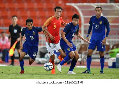 Xiao Zhi No.9 (red) of China in action during 2018The International Friendly Match between Thailand and China at the Rajamangala Stadium on June 2, 2018 in Bangkok,Thailand,