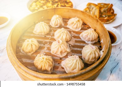 Xiaolongbao, Traditional Chinese food, dim sum. Traditional Chinese dumpling with shrimp and pork inside. shrimp shumai steam ready to be served. Traditional breakfast Xiao long bao. Shumai with soup.
