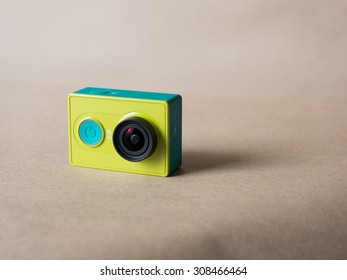 Xiaomi Yi Action Camera light green color on brown paper background