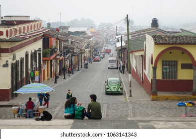 XICO, VERACRUZ, MEXICO- FEBRUARY 2, 2018: View of principal street with people and cars in a cloudy day at magical town Xico, Veracruz, Mexico