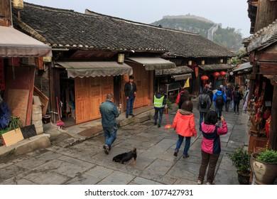 Xijiang, China - March 25, 2018: Tourists visiting the Qingyan ancient town in Guizhou, China