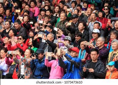 Xijiang, China - March 26, 2018: Crow of Chinese people in in Xijiang Miao Nationality village in Guizhou