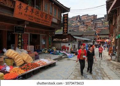 Xijiang, China - March 26, 2018: Local market in Xijiang Miao Nationality village in Guizhou