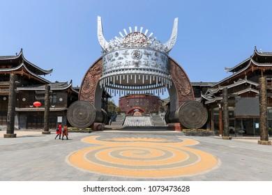 Xijiang, China - March 26, 2018: Statue of Miao traditional hat at the entrance of Xijiang Miao Nationality village