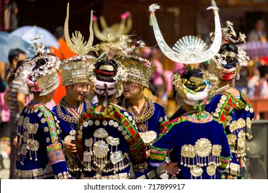 Xijiang, China - September 15, 2007: Group of ethnic minority Miao women in blue traditional festival clothes and silver headdress wait for ceremony start at Miao village in Xijiang, Guizhou, China
