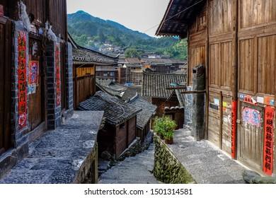 Xijiang, Qiandongnan Miao and Dong Autonomous Prefecture, Guizhou Province, China - August 2019 : the traditional wooden Miao architecture of Datang Xinqiao Village