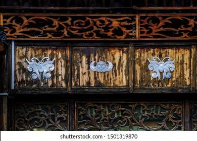 Xijiang, Qiandongnan Miao and Dong Autonomous Prefecture, Guizhou Province, China - August 2019 : traditional decorations of Miao buildings