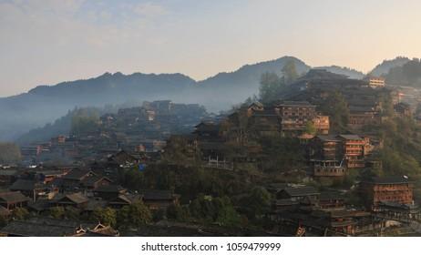 Xijiang Qianhu Miao Village in Guizhou, China at sunrise