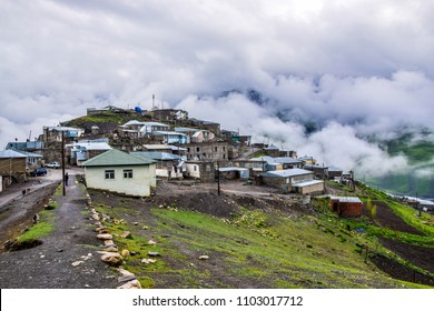 Xinaliq ( Khinalug ) - spectacular mountain village in the High Caucasus, Azerbaijan. Clouds surrounds the houses on a stormy summer day.