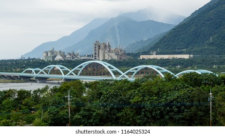 Xincheng, Hualien, Taiwan - January 2 2016: Highway Bridge over the Taroko River. In the background the Asia Cement Corporation, Hualien Plant