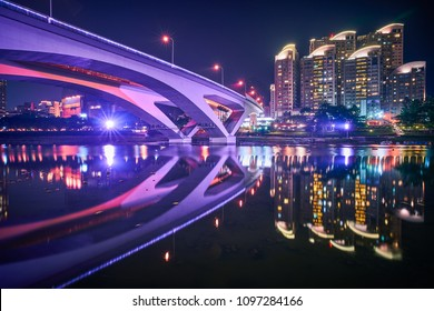 Xindian Night View - City skyline and water reflection at night in New Taipei, Taiwan.