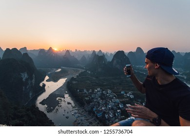 Xing Ping, China - October 31, 2017: Hiked up to catch this beautiful view of Xing Ping sunset,