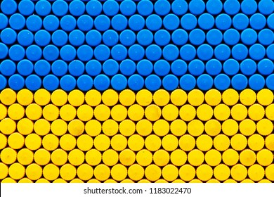 Xing yellow Texture, background from cork of plastic bottles.Blue and yellow colors of national flag of Sweden, Ukraine