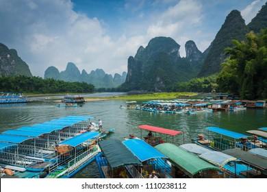 XINGPING, CHINA - MAY 29, 2018: Li River (Lijiang River). Pleasure boats at the pier in Xingping Town