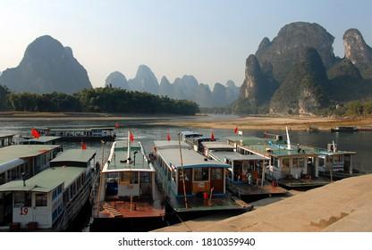 Xingping, Guangxi Province / China - Dec 12 2008: Boats moored on the Li River between Guilin and Yangshuo. Boats and beautiful Li River scenery in Xingping near Guilin.