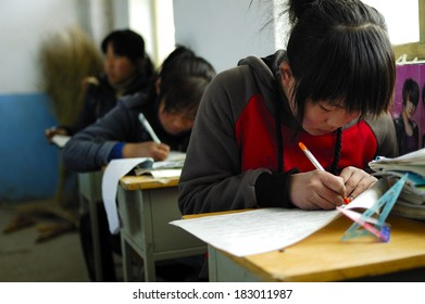XINGTAI CITY, CHINA - APRIL 1,2010: In April 1, 2010, Baixiang County school exams, unidentified students write papers in a serious answer.