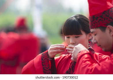 Xingtai City, China - April 2014: In the April 30, 2014, baixiang County held a Chinese Han-style mass wedding. A total of 16 unidentified couple took part in the mass wedding.
