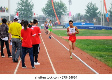 Xingtai City, Hebei Province, China - June 2012: On June 1, 2012 Chinese University Games, in the men's 10,000 m race, the athletes worked hard on the runway.