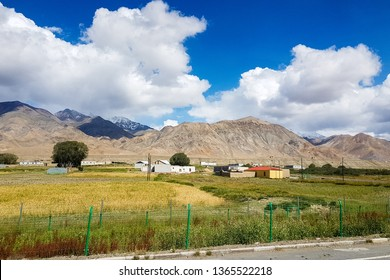 Xinjiang, China: local villages and mountains on the Pamir Plateau along Karakorum Highway, near Tashkurgan. Connecting Kashgar and the Pakistan Border, this road some of the best views of China