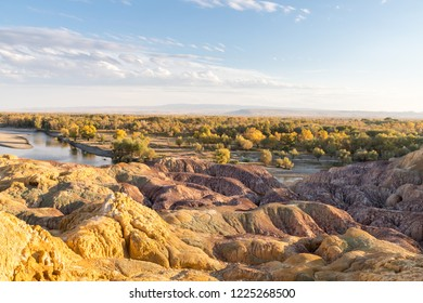 xinjiang colorful beach at dusk, formed by the influence of natural effects such as wind erosion and water erosion and leaching, irtysh river, burqin county