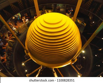 Xinyi, Taipei / Taiwan - September 19, 2017 : A golden largest tuned mass Damper inside Taipei 101 which keep building stable during strong winds.