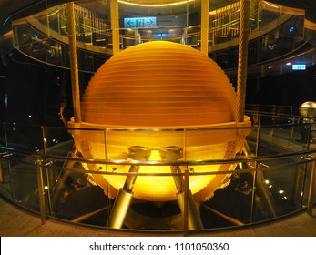 Xinyi, Taipei / Taiwan - September 19, 2017 : A golden 728 ton tuned mass Damper inside Taipei 101 building which help keep building from swaying.