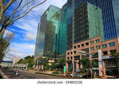 Xizhi District, New Taipei City, Taiwan - July 5, 2015 : U-TOWN building and street with beautiful sky, the first floor of building contains discount store, restaurant and bank, etc.