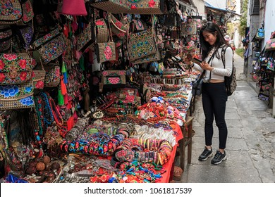 Xizhou, China - March 22, 2018: Chinese girl in a local market in Xizhou close to Dali Old Town in Yunnan