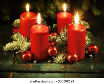 Xmas Advent wreath with four lighted candles for the 4th advent sunday rustic christmas traditional concept