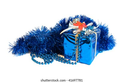 Xmas blue decorative wrapped present and beads on white background