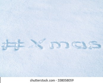 #Xmas hash tag written on blue snow, christmas hashtag lettering
