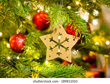 Xmas Ornament in a real Christmas tree in bright color
