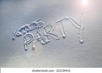 Xmas party word message with heart on the snow.