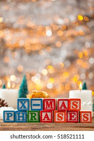 X-Mas Phrases Written With Toy Blocks On Christmas Card Vertical Background With Copy Space.