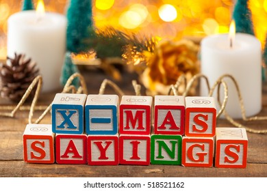 X-Mas Sayings Written With Toy Blocks On Christmas Card Background With Copy Space.