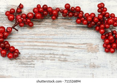 xmas star and berries on wood