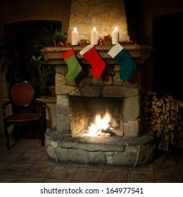 xmas stockings on chimney place background. real fire. vintage interior (front view)