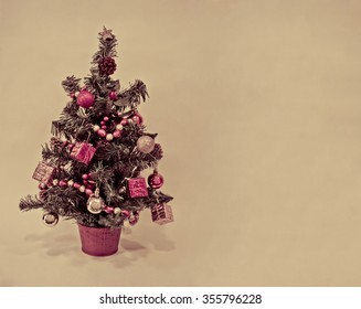 Xmas tree decorated with gifts and balls. Vintage style christmas card