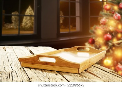 xmas tree and wooden desk with wooden tray