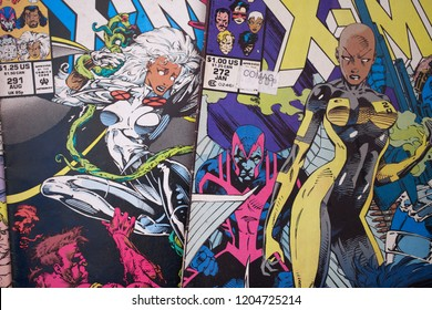 X-men comic books published by Marvel Comics featuring a black character called Storm, also made into live action feature films by 20th Century Fox, played by actress Halle Berry.